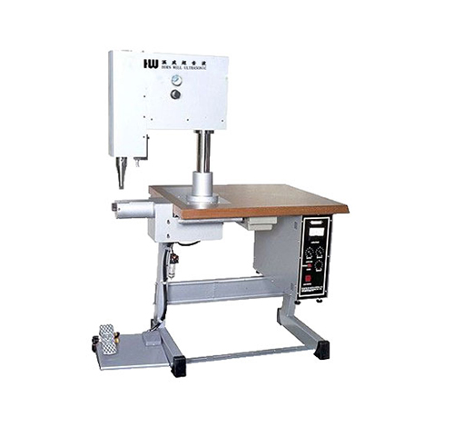 Surgical gown manufacturing machine